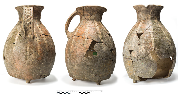A near-complete tripod pitcher in medieval Oxford Ware, recovered from the latrine