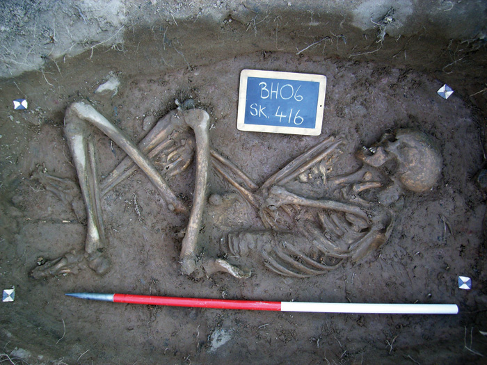 Skeleton of individual in his 60s when he died, with scale and label