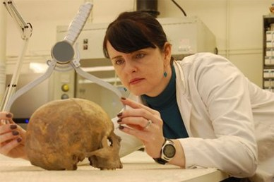 Dr Shirley Curtis-Summers measuring a skull
