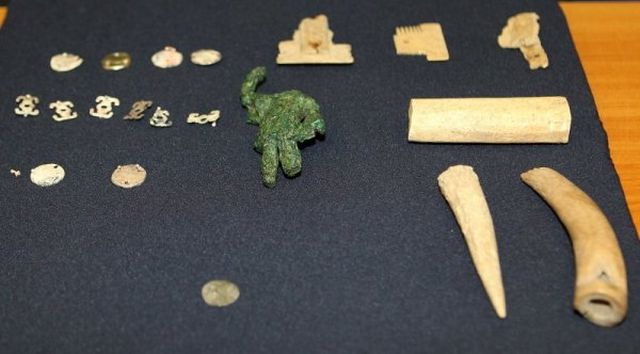The maimed Mars figurine together with other archaeological artifacts found in the ancient and medieval city of Missionis / Krum's Fortress near Bulgaria's Targovishte. Photo: BTA