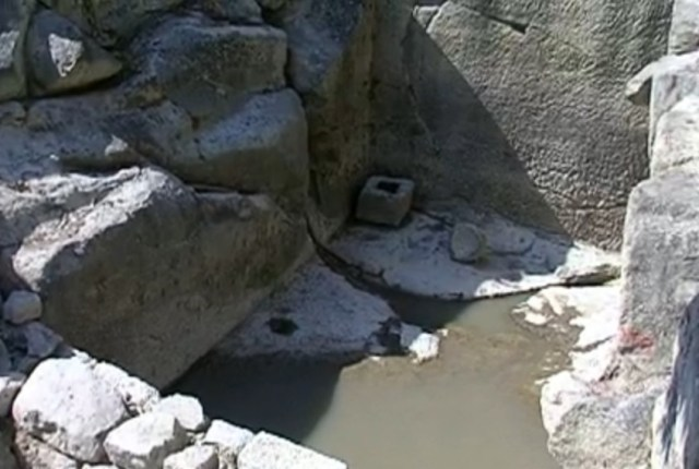 An ancient water tank hacked into the rock in the ancient and medieval city of Perperikon in Southern Bulgaria has not been found to have been a fountain, and may have been a nymphaeum, a monument dedicated to the nymphs. Photo: TV grab from BNT