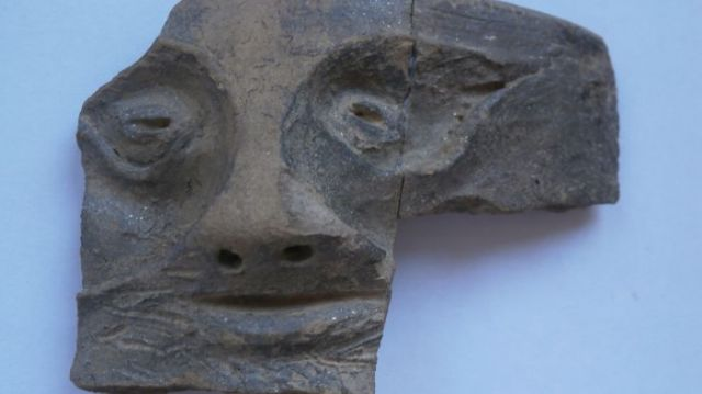 This mask of a satyr, a male companion of wine god Dionysus with equine features, which is in fact a fragment from a ceramic vessel, has been found during the 2015 summer excavations of emporium Pistiros near Vetren in Southern Bulgaria, an Ancient Greek trading post deep into the territory of the Ancient Thracian Odrysian Kingdom, which saw its height in the 4th century BC. Photo: Kmeta