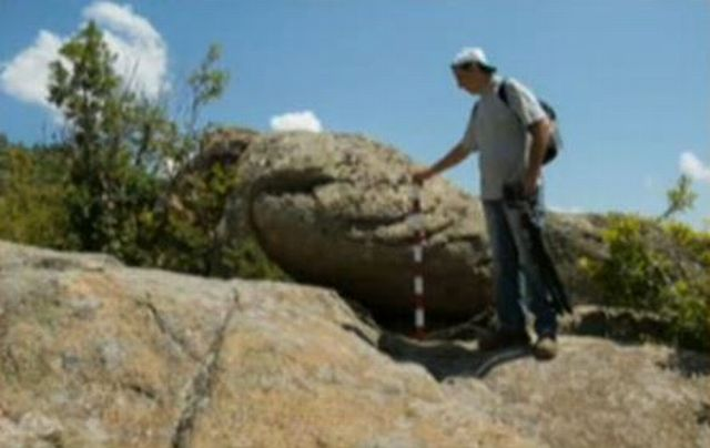 """The giant """"stone egg"""" found at the megalithic site near Bulgaria's Zlatosel is said to have fallen off from its original position. Photo: TV grab from BNT"""