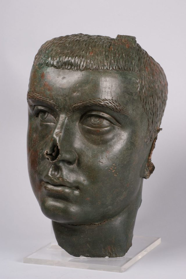 "Side views of the bronze head sculpture of Roman Emperor Gordian III providing a clearer picture of how the artifact was subjected to the Roman custom of ""condemnation of memory"" - its ears have been cut off, and its nose has been smashed with a stone. Photos: Central Library of the Bulgarian Academy of Sciences/National institute and Museum of Archaeology/Europeana Carare Project"