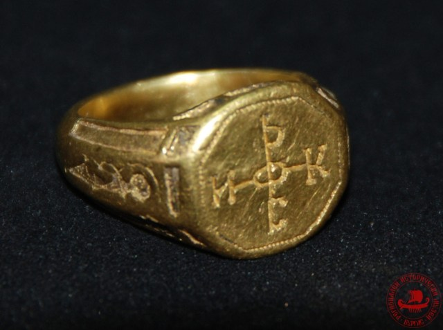 "The second ring, which may have belonged to a Byzantine noble, has has an engraving of a cross-like monogram reading in Greek, ""NIKHФOPOC"