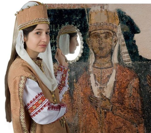 "The cover of the book ""Bulgarian Medieval Garments (13th-14th Century"" features the author Kalina Atanasova in medieval Bulgarian clothing posing together with a mural that the respective female costume reconstruction is based on. Photo: Badamba"
