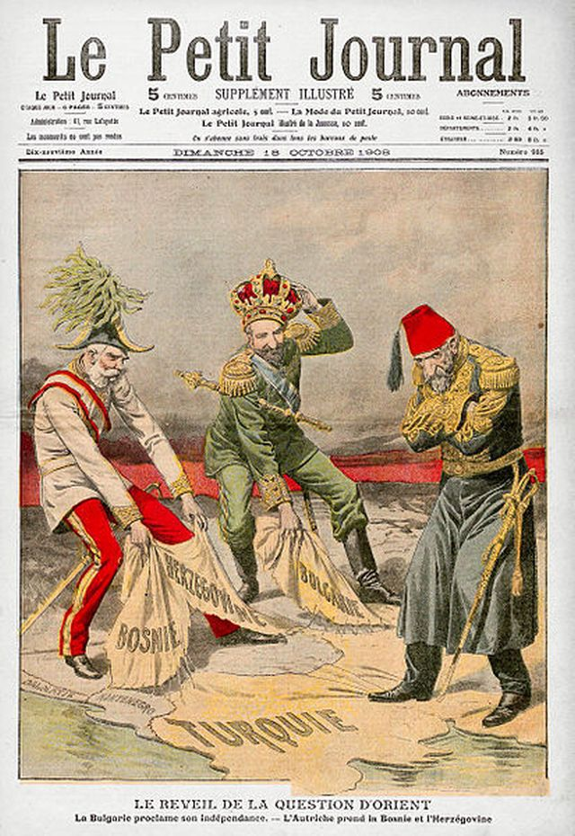 This political cartoon on the cover of French periodical Le Petit Journal illustrates the Bosnian Crisis of 1908: King Ferdinand (middle) of Bulgaria declares independence and becomes Tsar, Austro-Hungarian Emperor Franz Joseph (L) annexes Bosnia and Herzegovina, while Ottoman Sultan Abdul Hamid looks on. Photo: Cplakidas, Wikipedia