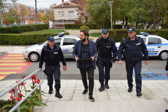 Archaeologist Daniel Pantov is seen bringing the treasure to the Primorsko Museum of History with an escort by the local police. Photo: Primorsko Municipality