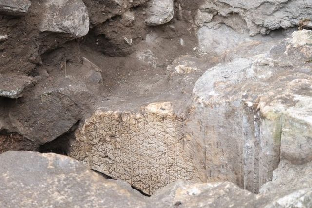The architectural fragment bearing the 1st century AD inscription was discovered built into a 4th century AD straicase underneath the stage of the Antiquity Theater of ancient Philipopolis in Bulgaria's Plovdiv. Photos: Plovdiv24