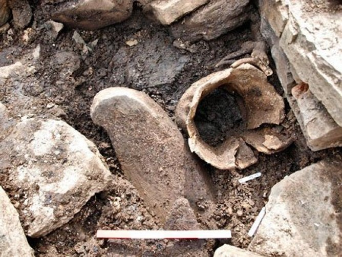 The-whalebone-vessel-quern-and-antlers-shortly-before-being-recovered-from-the-ground