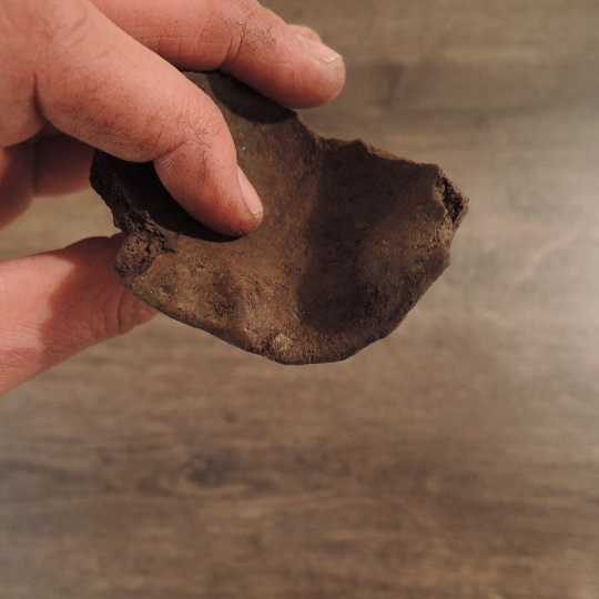 The crucible showing the spout that would have been used for pouring molten bronze