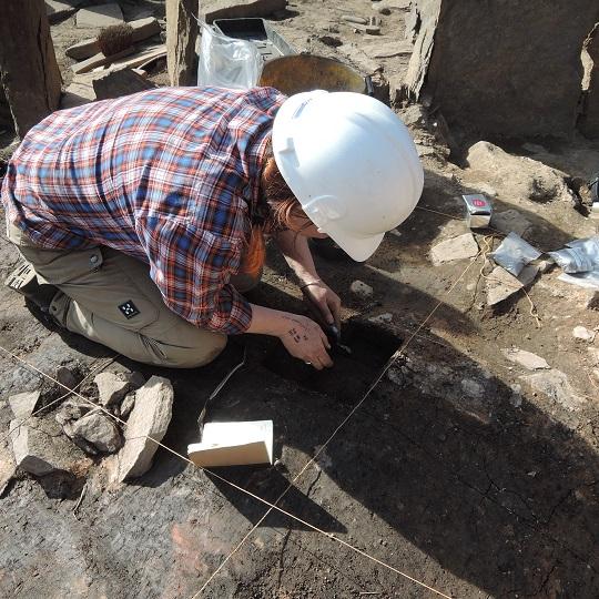 Jo sampling the broch floor deposits