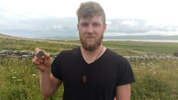 Ross with his coin find