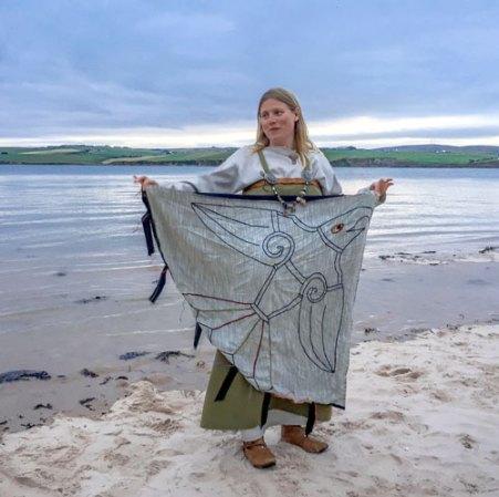Ragnhild Ljosland with a reconstruction of Earl Sigurd's Raven Banner.