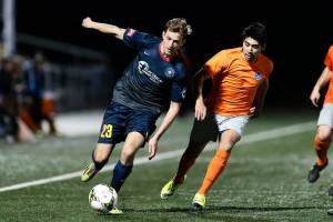 Jordan Roberts tries to break away down the right wing against Tulsa on Saturday night