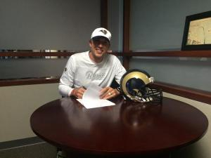 Nick Foles after signing his contract extension on Friday night. Photo via the St. Louis Rams Twitter page: @STLouisRams