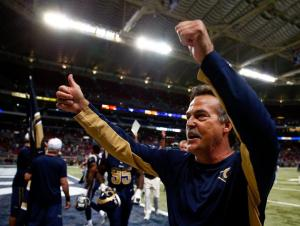 Rams HC Jeff Fisher gives a thumbs-up to the crowd before exiting the field after the Rams victory.