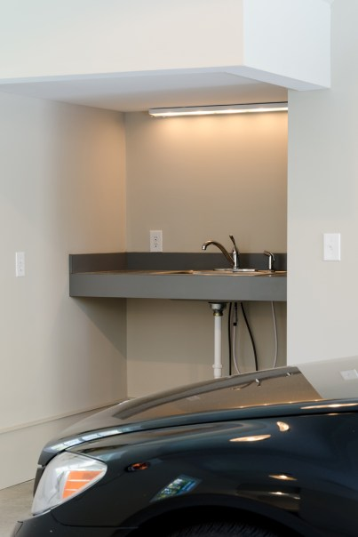 Sink and counter top installed in the corner of the parking bays.