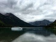Low clouds drape themselves over the mountains surrounding Swiftcurrent Lake