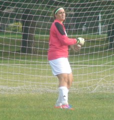 Ashley Leverenz, Mount Mary senior goalie, makes crucial saves to keep the Blue Angels in the game.
