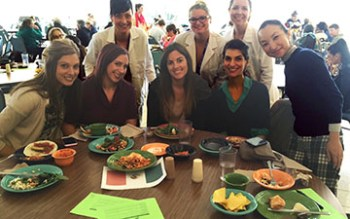 Dietetics students Rebekah Genich, Carly Michelz and Kris Bennett stand behind the students enjoying the Mexican-themed meal: Mandy Mindin, Kelli Dunham, Alexa Eisenberg, Brenna Sunderland-Saied and Miyoshi Pokrand.