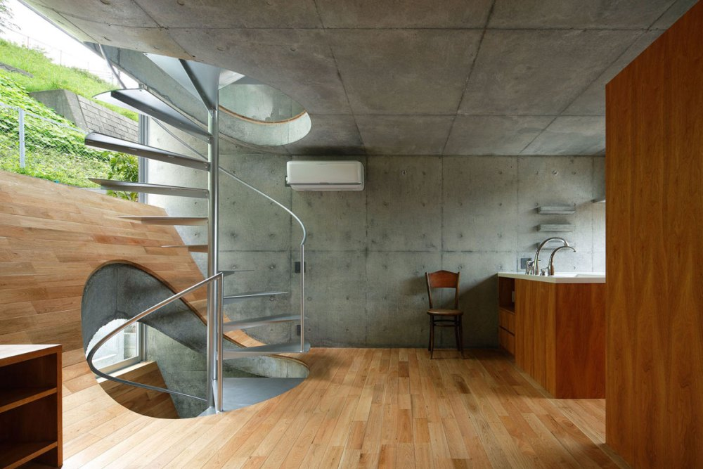 Wood floors curved and concrete ceilings