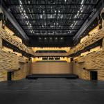 The Multipurpose Hall is designed for a 700 seat audience. The walls are clad with solid CNC cut bamboo blocks, shaped according to the acoustic needs. The roof is equipped with a flexible cable net ceiling to enable a flexible usage of lighting and other technical equipment.