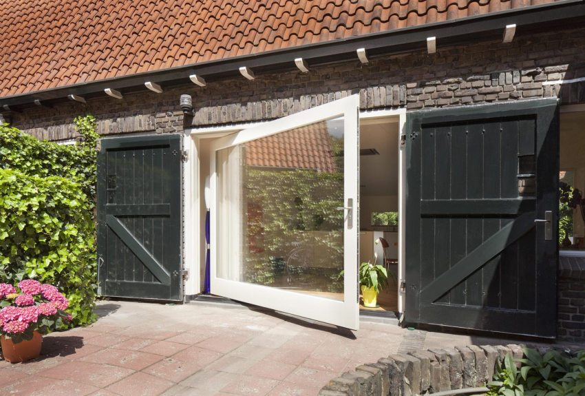 Modern Pivot door in a farmhouse