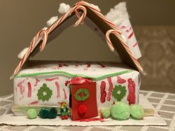 A red and white festive elf house made by a 6 year old