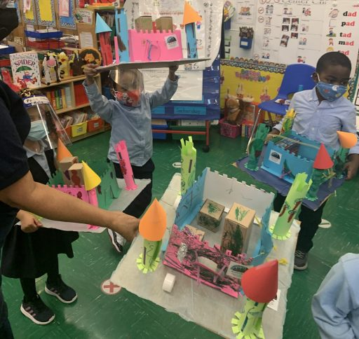 Students show off their castle projects