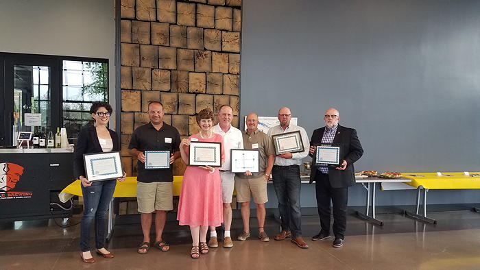2021 ARCHie winners, from left, Abbey Stombaugh, Kevin Gerbers, Kay Feichter, John Garzelloni and guest, Jon Anderson and Brooks Fetters