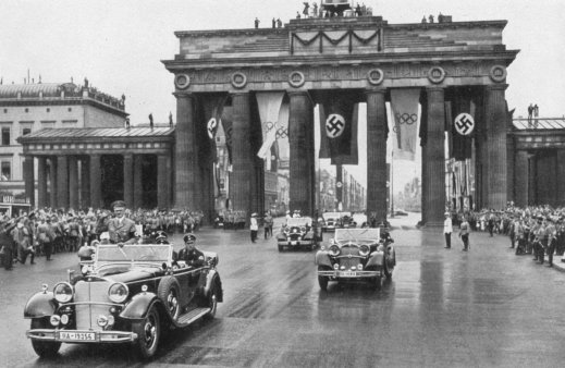 Berlin Olympics - 1936, The Führer Adolf Hitler, Patron of the Olympic Games, drives through the lines of enthusiastic people to open the Games officially. Photo by Past Pix