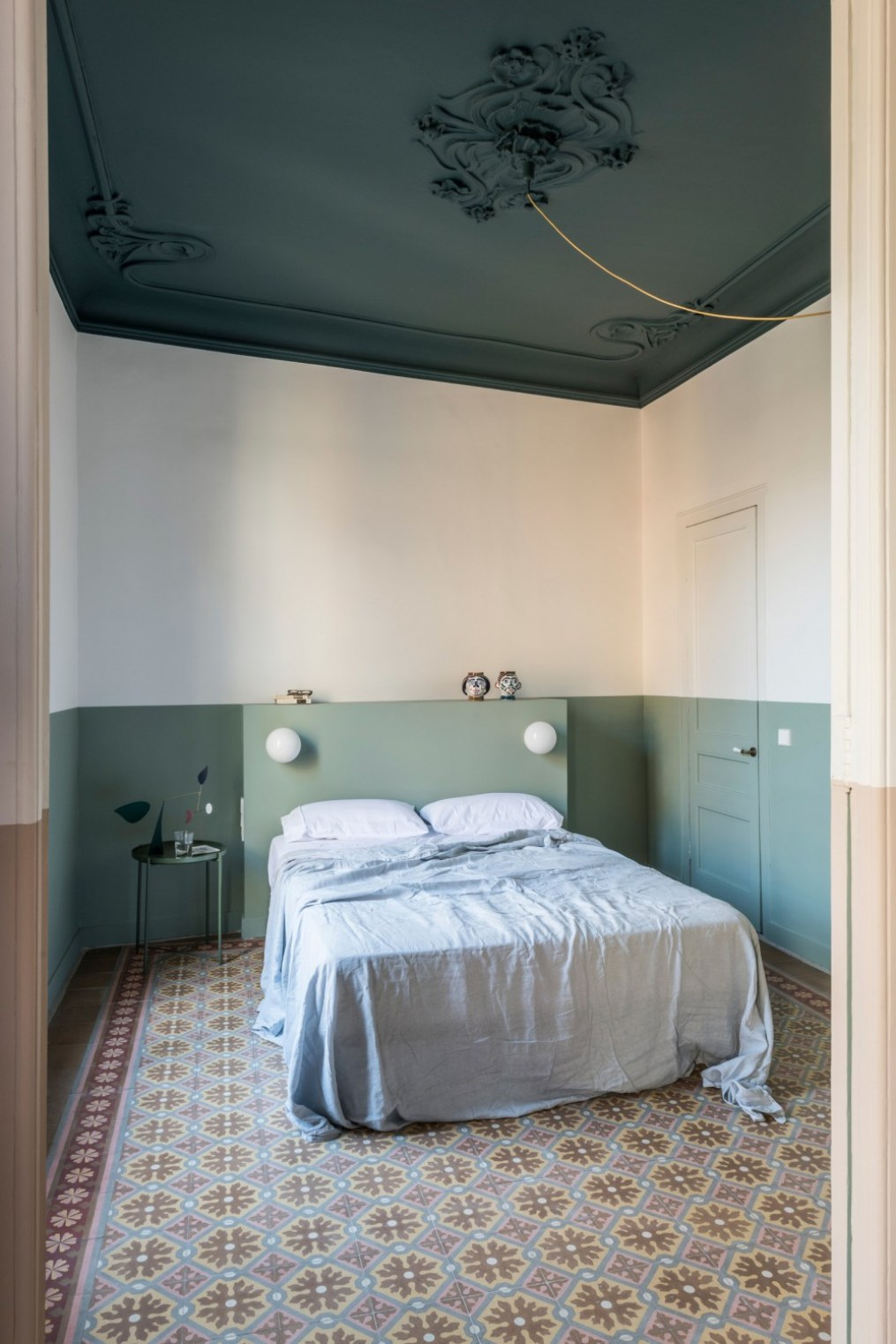 pThe master bedrooms mint walls were meant to be a complementary departure from the terracotta shade of the shared...