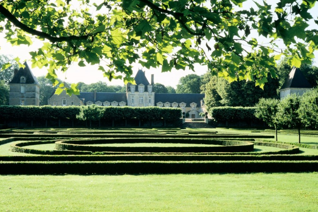formal boxwood gardens with a French chateau in the background