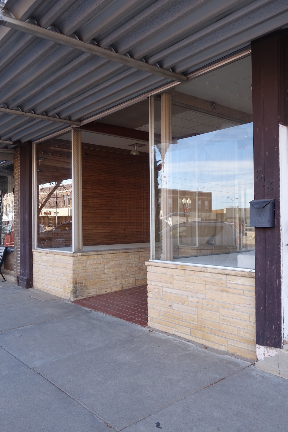 The plate glass display windows probably date to the 1950's.
