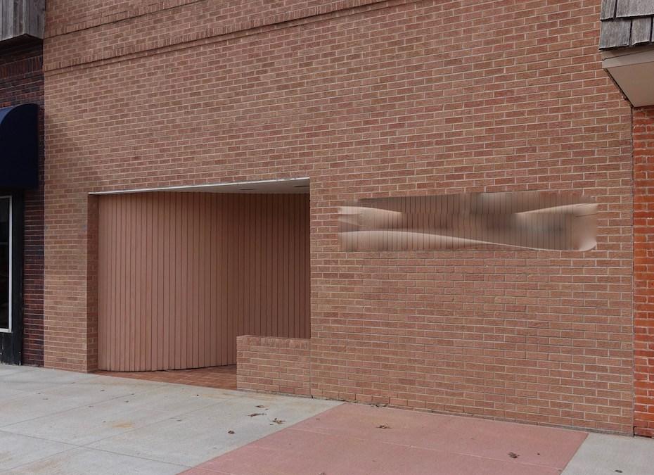 Windowless Facade w/ Recessed Entry