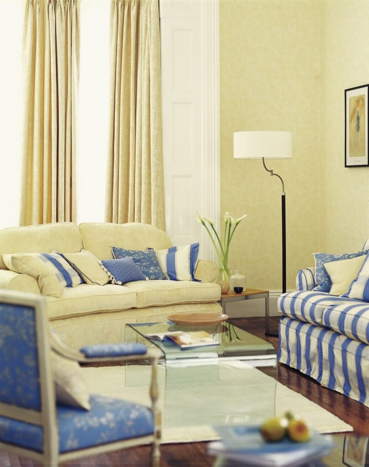 A pale butter yellow and cornflower blue living room with rich hardwood flooring and a subtle for Yellow and blue living room ideas