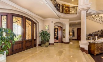 Mediterranean Entryway With Columns, Limestone Tile Floors, Crown Molding, High Ceiling