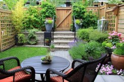 Small Townhouse Garden With Patio Furniture Amidst Blooming Lavender