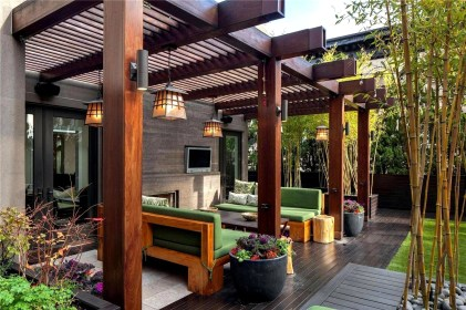 Closed Terrace Design With Big Wooden Pillars And Green Sofas Some Spotlight Fixtures Installed On Each Pillar