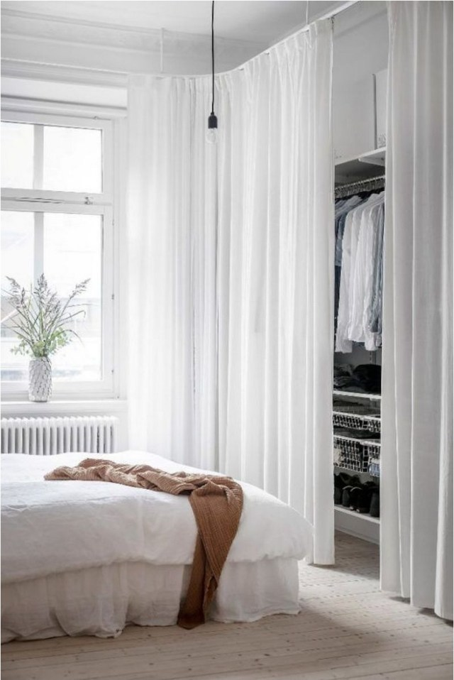 Minimalist Bedroom With Wardrobe And Curtains