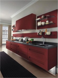 Modern Kitchen With Red Cabinet And Black Sink