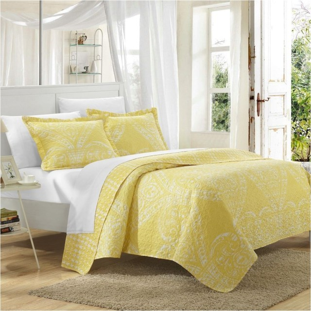 White Bedroom With Yello Bed Sheet Decorations