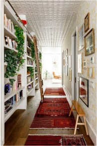 Hallway With Shelf And Picture Decorations