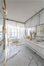 Luxury Bathroom Design With Gold Lamp Accent