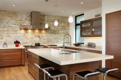 Contemporary Kitchen With Lovely Lighting And Stone Accent Wall