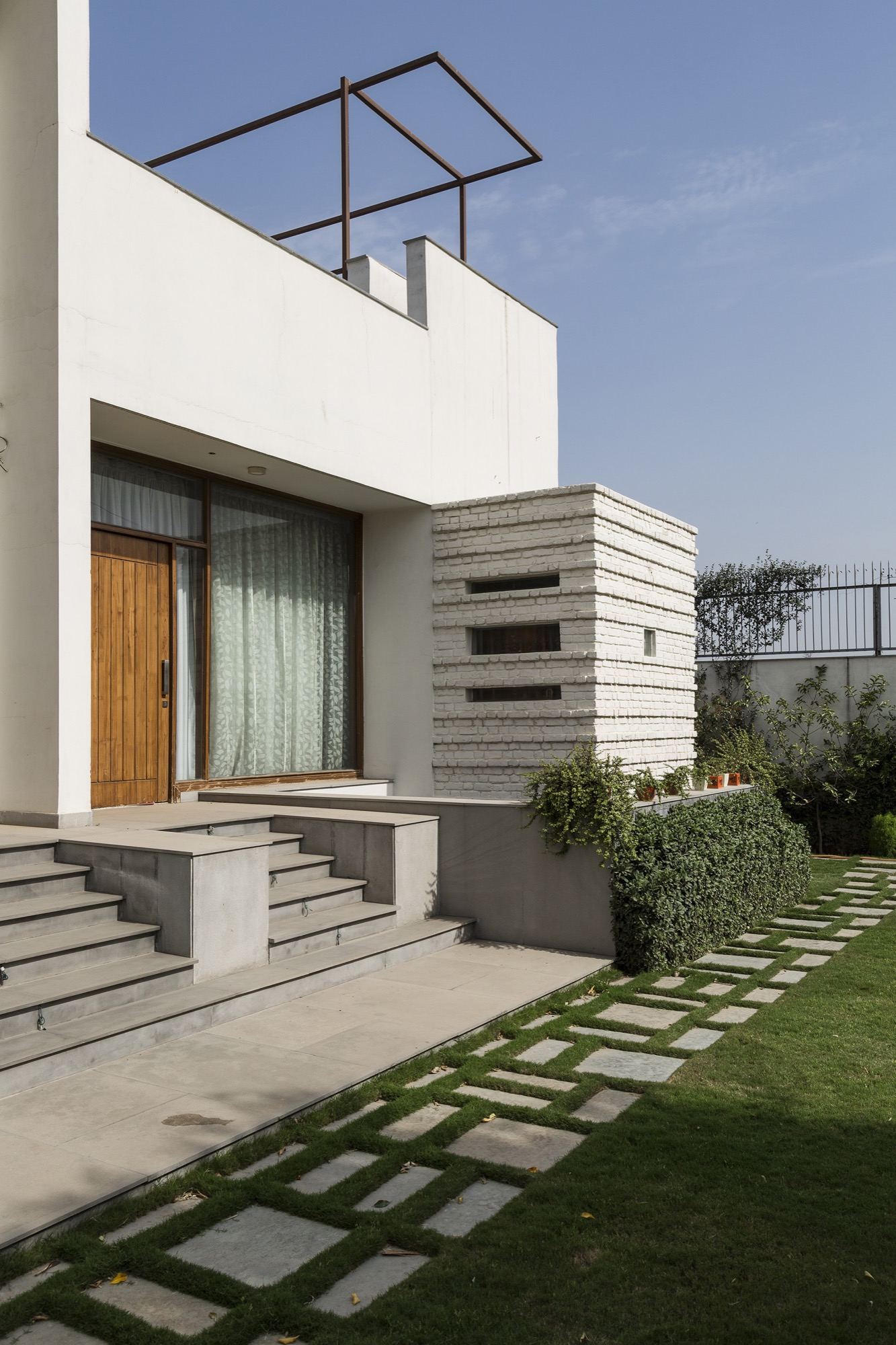 Neem-Aaangan, a house around neem tree in Delhi, by Design Bureau 21