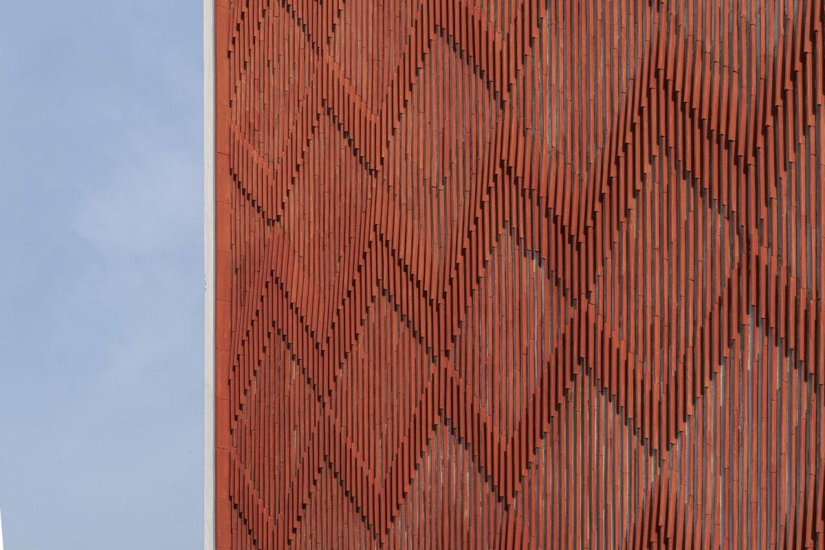 Clay roof tiles façade to minimize heat gain and has decorative function, at Vadodara, by Manoj Patel Design Studio 8
