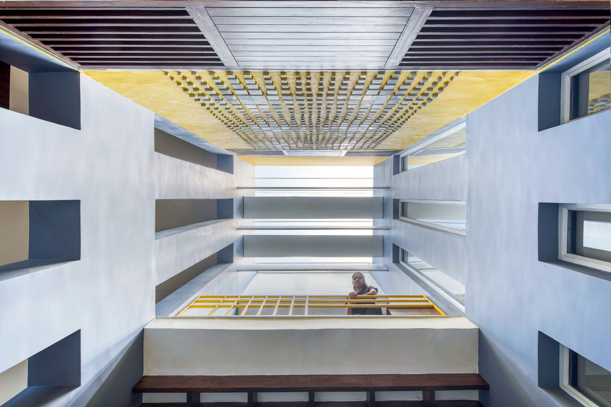 Clay roof tiles façade to minimize heat gain and has decorative function, at Vadodara, by Manoj Patel Design Studio 22