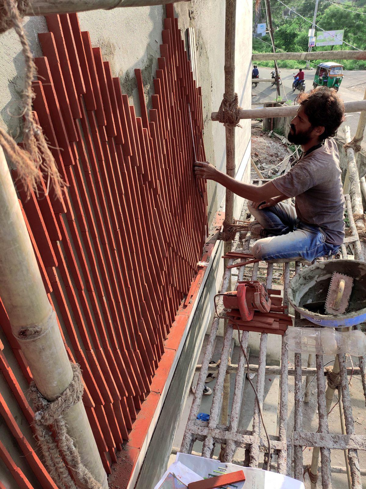 Clay roof tiles façade to minimize heat gain and has decorative function, at Vadodara, by Manoj Patel Design Studio 65